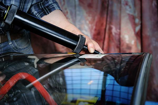 Repair and replacement of the windshield of the car.